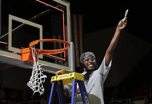 Photo - Stanford forward Chiney Ogwumike celebrates as she cuts down part of the net after Stanford's 74-65 win over North Carolina in a regional final at the NCAA women's college basketball tournament in Stanford, Calif., Tuesday, April 1, 2014. (AP Photo/Marcio Jose Sanchez)