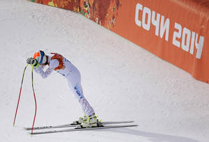 Photo - United States' Bode Miller reacts after his run in the men's downhill event at the 2014 Winter Olympics, Sunday, Feb. 9, 2014, in Krasnaya Polyana, Russia. (AP Photo/Charlie Riedel)