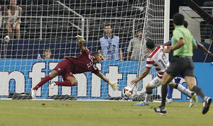 Photo - Honduras' goal keeper Donis Escobar (22) is unable to stop a shot by United States' Landon Donovan (10) during the first half of the Gold Cup semifinals at Cowboys Stadium, Wednesday, July 24, 2013, in Arlington, Texas. (AP Photo/Brandon Wade)