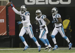 Photo - Carolina Panthers cornerback Melvin White (23) celebrates his touchdown after intercepting a ball thrown by Atlanta Falcons quarterback Matt Ryan during the first half of an NFL football game, Sunday, Dec. 29, 2013, in Atlanta. (AP Photo/John Bazemore)