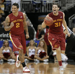 Photo - Iowa State guard Chris Babb (2) and forward Georges Niang (31) celebrate after winning an NCAA college basketball game against Oklahoma in the Big 12 men's tournament Thursday, March 14, 2013, in Kansas City, Mo. Iowa State won the game 73-66. (AP Photo/Charlie Riedel) ORG XMIT: MOCR114