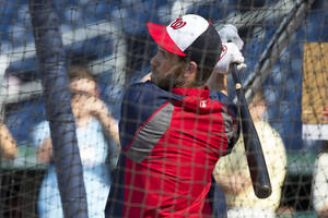 Photo - Washington Nationals outfielder Bryce Harper takes batting practice before the start of a baseball game against the Colorado Rockies at Nationals Park, on Monday, June 30, 2014, in Washington. The Nationals have reinstated Harper from the 15-day disabled list after the star outfielder missed 59 games because of a torn ligament in his left thumb. (AP Photo/ Evan Vucci)