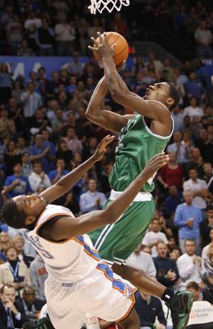 Photo - Boston Celtics guard Tony Allen, right, collides with Oklahoma City Thunder guard Kyle Weaver (5) during the first quarter of an NBA basketball game in Oklahoma City, Wednesday, Nov. 5, 2008. Allen was called for an offensive foul. (AP Photo/Sue Ogrocki) ORG XMIT: OKSO103