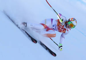 Photo - Liechtenstein's Tina Weirather makes a turn in a women's downhill training run for the Sochi 2014 Winter Olympics, Friday, Feb. 7, 2014, in Krasnaya Polyana, Russia. (AP Photo/Alessandro Trovati)