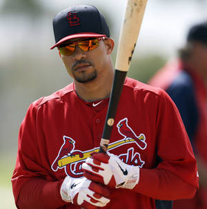Photo - FILE - St. Louis Cardinals shortstop Rafael Furcal waits to take batting practice during spring training baseball, in this Feb. 19, 2013 file photo taken in Jupiter, Fla. The free-agent infielder and the Marlins agreed to terms on a contract, two people familiar with the situation said Thursday Dec. 5, 2013. Furcal, a three-time All-Star, sat out this season after undergoing elbow ligament-replacement surgery in March.  (AP Photo/Julio Cortez, File)