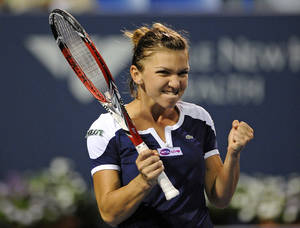 Photo - Simona Halep, of Romania, celebrates her 6-2, 7-5, semifinal victory over Caroline Wozniacki, of Denmark, at the New Haven Open tennis tournament in New Haven, Conn., on Friday, Aug. 23, 2013. (AP Photo/Fred Beckham)