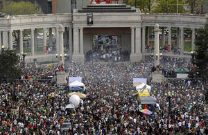 Photo - FILE - This April 20, 2012 file photo shows a cloud of smoke covering the crowd at the Denver 420 rally in Civic Center Park. Denver Police are bracing for this year's event on Saturday, April 20, 2013 which is expected to draw a record crowd of 80,000 people. (AP Photo/The Denver Post, Daniel Petty, File)