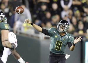 Photo -   Oregon quarterback Marcus Mariota unleashes a pass during the first half of their NCAA college football game against Arizona in Eugene, Ore., Saturday, Sept. 22, 2012. (AP Photo/Don Ryan)