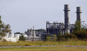photo -   This Oct. 3, 2012 photograph shows cooling towers at the KGen Power Corporation natural gas-fired plant in Jackson, Miss. The plant may one day be owned by the New Orleans-based utility, Energy Corporation, as part of larger purchase, if allowed by the U.S. Justice Department, which has reservations about the purposed purchase. (AP Photo/Rogelio V. Solis)