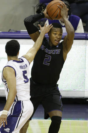 Photo - Kansas State guard Marcus Foster (2) looks to pass against TCU guard Kyan Anderson (5) during the first half of an NCAA basketball game in Fort Worth, Texas, Tuesday, Jan. 7, 2014. (AP Photo/LM Otero)
