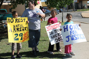 Photo - Michelle Petties, 36, of Oklahoma City, and her daughters participate in a protest for the death of Trayvon Martin in Oklahoma City Sunday. Martin, 17, was fatally shot on Feb. 26. <strong>TIFFANY GIBSON - THE OKLAHOMAN</strong>