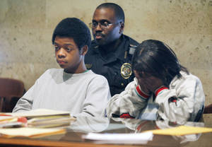 Photo - A relative shows her emotion as Jevontia Ingram awaits his sentence by Judge Watson at the Oklahoma County courthouse in Oklahoma City, OK, Friday, Jan. 8, 2010. Ingram was involved in the pharmacy robbery in which another suspect was killed. By Paul Hellstern, The Oklahoman