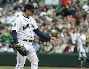 photo -   Seattle Mariners starting pitcher Jason Vargas tosses the ball after giving up a solo home run to Boston Red Sox's Dustin Pedroia in the eighth inning of a baseball game, Sunday, July 1, 2012, in Seattle. (AP Photo/Ted S. Warren)