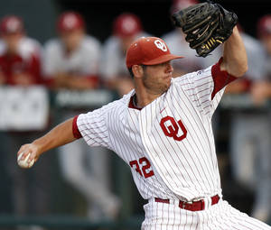 Photo - Oklahoma's Damien Magnifico pitches  against Arkansas at L. Dale Mitchell Park in Norman, Okla., Tuesday, April 10, 2012. Photo by Bryan Terry, The Oklahoman
