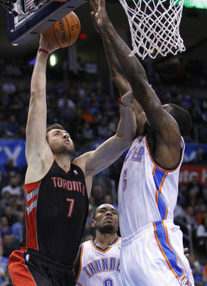 photo -   Toronto Raptors center Andrea Bargnani (7) goes up for a basket in front of Oklahoma City Thunder center Kendrick Perkins (5) during the first quarter of an NBA basketball game in Oklahoma City, Tuesday, Nov. 6, 2012. (AP Photo/Alonzo Adams)