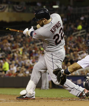 Photo - Cleveland Indians' Jason Kipnis hits an RBI-triple off Minnesota Twins pitcher Pedro Hernandez in the first inning of a baseball game on Friday, Sept. 27, 2013, in Minneapolis. (AP Photo/Jim Mone)