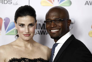 "Photo - FILE - This Feb. 17, 2012 file photo shows Idina Menzel, left, and Taye Diggs at the 43rd NAACP Image Awards in Los Angeles. A publicist for the couple announced their breakup Thursday, Dec. 12, 2013 in a statement that said the separation was ""jointly decided"" and that ""primary focus and concern is for their son.""(AP Photo/Matt Sayles, File)"