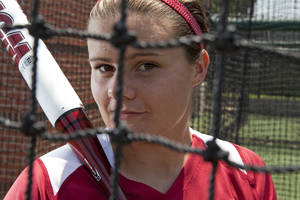 Photo - University of Oklahoma softball player Georgia Casey (from Australia and OU's first-ever international player) poses for the photographer on Thursday, May 24, 2012, in Norman, Okla.  Photo by Steve Sisney, The Oklahoman