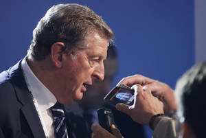 Photo - England manager Roy Hodgson answers questions after the draw ceremony for the 2014 soccer World Cup in Costa do Sauipe near Salvador, Brazil, Friday, Dec. 6, 2013. (AP Photo/Victor R. Caivano)