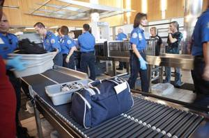 Photo - TSA agents process travelers through a security checkpoint at Will Rogers World Airport. PHOTO BY BRYAN TERRY, THE OKLAHOMAN