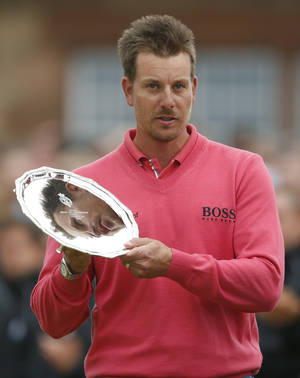 Photo - Runner up Henrik Stenson of Sweden holds his trophy after the British Open Golf Championship at Muirfield, Scotland, Sunday July 21, 2013. (AP Photo/Peter Morrison)