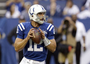 Photo - Indianapolis Colts quarterback Andrew Luck throws against the Cleveland Browns during the first half of a preseason NFL football game in Indianapolis, Saturday, Aug. 24, 2013. (AP Photo/Michael Conroy)