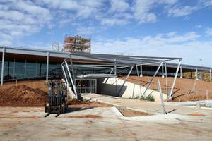 Photo - This view shows the main entrance on the east side of the Metropolitan Library System branch under  construction at 5200 NW 122.