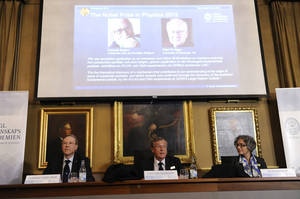Photo - Chairman Gunnar Ingelman, left, permanent secretary Staffan Normark, center, and board member Olga Botner of the Royal Swedish Academy of Sciences announce the 2013 Nobel Prize in Physics is awarded to British physicist Peter Higgs and Belgian theoretical physicist Francois Englert during a press conference at the Royal Swedish Academy of Sciences in Stockholm, Sweden, Tuesday Oct. 8, 2013. (AP Photo/Erik Martensson, TT News Agency) SWEDEN OUT