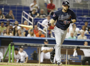 Photo - Atlanta Braves' Chris Johnson draws a walk in the eighth inning in the of a baseball game against the Miami Marlins, Thursday, May 1, 2014, in Miami. The Marlins defeated the Braves 5-4. (AP Photo/Lynne Sladky)