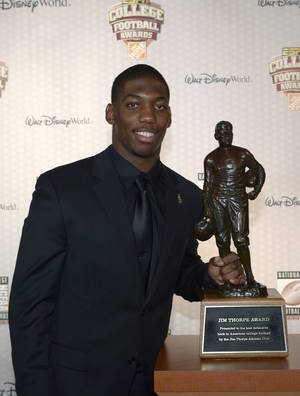 Photo - Michigan State defensive back Darqueze Dennard poses with the Jim Thorpe Award after winning the honor during the College Football Awards show in Lake Buena Vista, Fla., Thursday, Dec. 12, 2013. (AP Photo/Phelan M. Ebenhack)