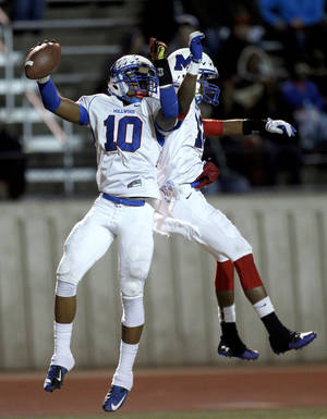 Photo - Millwood's Alfonzo McMillian (10) and Micah Sanders celebrate a touchdown during the Class 2A state football championship game between Davis and Millwood at Moore High School in Moore, Okla.,  Thursday, Dec. 19, 2013. Photo by Sarah Phipps, The Oklahoman