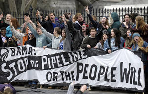 Photo - People protest against the XL Pipeline outside the White House in Washington, Sunday, March 2, 2014. (AP Photo/Susan Walsh)