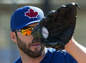 Photo - Toronto Blue Jays pitcher Brandon Morrow catches a ball during a fielding drill on the first official day of spring training on Monday, Feb. 17, 2014, in Dunedin, Fla. (AP Photo/The Canadian Press, Frank Gunn)