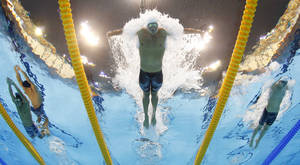 Photo -   USA's Ryan Lochte competes in a men's 400-meter individual medley at the Aquatics Centre in the Olympic Park during the 2012 Summer Olympics in London, Saturday, July 28, 2012. (AP Photo/David J. Phillip)