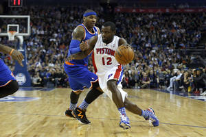 Photo - Detroit Pistons guard Will Bynum, right, tries to get past New York Knicks forward Carmelo Anthony during their NBA basketball game at the 02 arena in London, Thursday, Jan. 17, 2013.  (AP Photo/Matt Dunham)