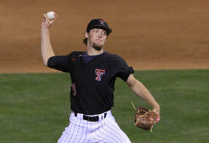 Photo - Texas Tech pitcher Johnathon Tripp pitches in the eighth inning of a first-round game against Texas in the Big 12 conference NCAA college baseball tournament in Oklahoma City, Wednesday, May 21, 2014. Texas won 8-3. (AP Photo/Alonzo Adams)