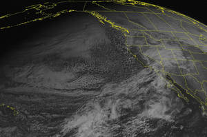 photo - This NOAA satellite image taken Tuesday, December 18, 2012 at 02:00 PM EST shows a few clouds in the Rockies where low pressure continues to develop.  This low will intensify through the week, eventually bringing a strong winter storm to the Northeast. (AP Photo/Weather Underground)
