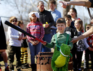 photo - Alex Cossey, 3, is directed toward a pinata during a Purim carnival at Temple Bnai Israel in Oklahoma City.Photos by Bryan Terry, THE OKLAHOMAN