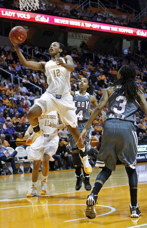 Photo - Tennessee forward Bashaara Graves (12) puts up a shot between Troy guard Ashley Beverly-Kelley (4) and Joanna Harden (3) in the first half of an NCAA college basketball game on Saturday, Dec. 14, 2013, in Knoxville, Tenn. (AP Photo/Wade Payne)