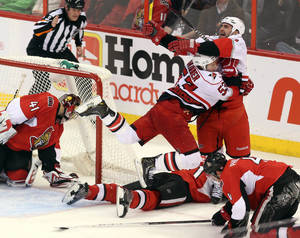 photo - Carolina Hurricanes&#039; Jay Harrison (44) celebrates his winning goal in overtime with teammate Jeff Skinner (55) to defeat the Ottawa Senators in an NHL hockey game in Ottawa, Ontario, Thursday, Feb. 7, 2013. (AP Photo/The Canadian Press, Fred Chartrand)
