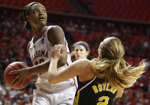 Photo - Oklahoma's Kaylon Williams (42) runs into Michigan's Courtney Boylan (2) during a first round game of the NCAA women's basketball tournament between the University of Oklahoma Sooners and the Michigan Wolverines at Lloyd Noble Center in Norman, Okla., Sunday, March 18, 2012. Oklahoma won 88-67. Photo by Bryan Terry, The Oklahoman