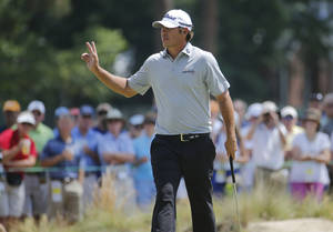 Photo - Brooks Koepka waves on the sixth green during the second round of the U.S. Open golf tournament in Pinehurst, N.C., Friday, June 13, 2014. (AP Photo/Matt York)