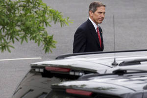Photo - Deputy Veterans Affairs Secretary Sloan Gibson leaves the White House in Washington, Friday, May 30, 2014, after being named by President Barack Obama to run the Veterans Affairs Department on an interim basis while Obama searches for a replacement for Veterans Affairs Secretary Eric Shinseki who resigned Friday. (AP Photo/Jacquelyn Martin)
