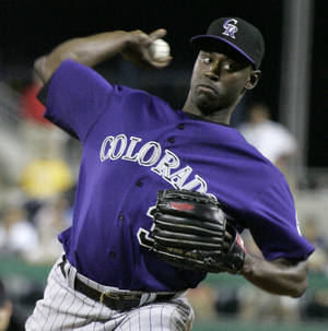 Photo - FILE - This July 16, 2007 file photo shows Colorado Rockies relief pitcher LaTroy Hawkins throwing against the Pittsburgh Pirates during a baseball game in Pittsburgh. Hawkins is returning to the Rockies and the veteran reliever may just possibly wind up as their closer. Hawkins agreed to a one-year, $2.5 million deal on Tuesday, Nov. 19, 2013, a person familiar with the negotiations told The Associated Press. (AP Photo/Gene J. Puskar, File)