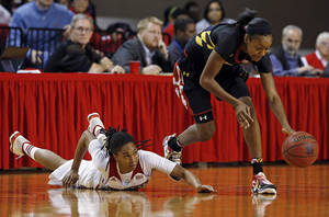 Photo - Maryland's Shatori Walker-Kimbrough, right, takes the ball away from North Carolina State's Krystal Barrett during the first half of an NCAA college basketball game in Raleigh, N.C., Thursday, Jan. 30, 2014. (AP Photo/Karl B DeBlaker)