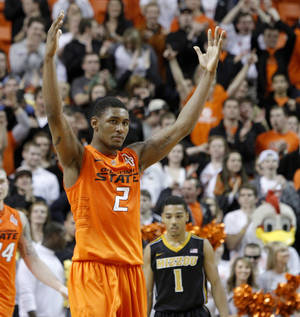 Photo - Oklahoma State's Le'Bryan Nash (2) celebrates during an NCAA college basketball game between the Oklahoma State University Cowboys (OSU) and the Missouri Tigers (MU) at Gallagher-Iba Arena in Stillwater, Okla., Wednesday, Jan. 25, 2012. Photo by Bryan Terry, The Oklahoman