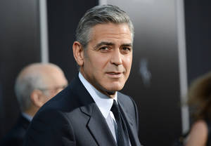 "Photo - FILE - In this Oct. 1, 2013 file photo actor George Clooney attends the premiere of ""Gravity"" at the AMC Lincoln Square Theaters, in New York. George Clooney has chastised a British newspaper over an article claiming his fiancee's mother disapproves of the impending marriage for religious reasons. Clooney said that the claims about his future mother-in-law Baria Alamuddin were untrue and irresponsible. (Photo by Evan Agostini/Invision/AP, File)"