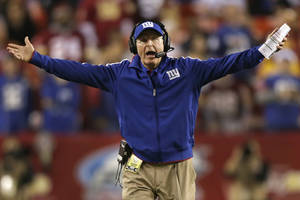 Photo - New York Giants head coach Tom Coughlin reacts to a call during the first half of an NFL football game against the Washington Redskins in Landover, Md., Monday, Dec. 3, 2012. (AP Photo/Evan Vucci)