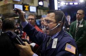 Photo - Traders work on the floor at the New York Stock Exchange in New York, Tuesday, Sept. 3, 2013. The stock market started September with a rally Tuesday as worries of an imminent U.S. attack on Syria faded. (AP Photo/Seth Wenig)
