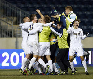 Photo - Notre Dame players celebrate after defeating Maryland 2-1 during the championship game of the NCAA Division 1 Men's Soccer tournament at PPL Park in Chester, Pa., Sunday, Dec. 15, 2013. (AP Photo/Rich Schultz)